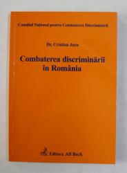 COMBATEREA DISCRIMINARII IN ROMANIA de Dr. CRISTIAN JURA , 2004